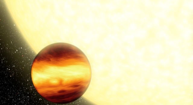 This artist's concept shows a gas-giant planet orbiting very close to its parent star, creating searingly hot conditions on the planet's surface.