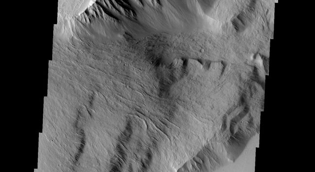 This spectacular image shows part of the escarpment of the Olympus Mons volcano on Mars as seen by NASA's Mars Odyssey spacecraft.