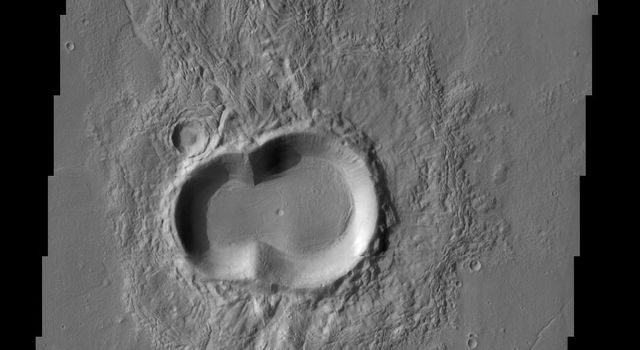 This doublet crater on Mars looks like a melting snowman tipped on his side. Warmth is in the air, as the southern hemisphere of Mars enters spring as seen by NASA's Mars Odyssey spacecraft.
