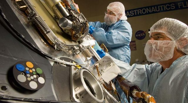Lockheed Martin Space Systems technicians work on the science deck of NASA's Phoenix Mars Lander