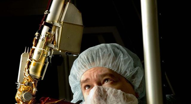 A spacecraft technician inspected the vital robotic arm of NASA's Phoenix Mars Lander during the assembly phase of the mission.