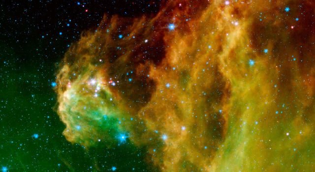"This image from NASA's Spitzer Space Telescope shows infant stars ""hatching"" in the head of the hunter constellation, Orion. The region featured in this Spitzer image is called Barnard 30."