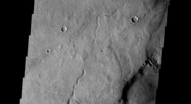 This image from NASA's Mars Odyssey spacecraft shows a portion of Dao Vallis on Mars. The channel of Dao Vallis is very complex and contains regions of chaos.