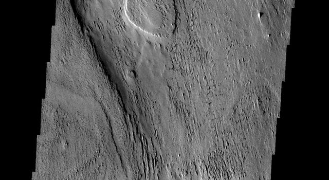 This image from NASA's Mars Odyssey spacecraft shows erosion and the removal of material in a region just southeast of Apollineris Patera on Mars. The material may be volcanic ash from the nearby patera.