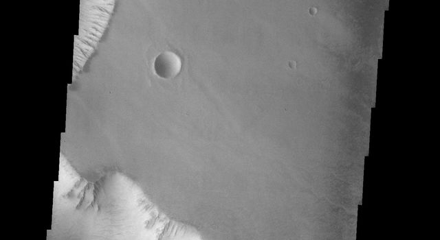 This image from NASA's Mars Odyssey spacecraft shows two diamond-shaped crater on the surface of Mars.