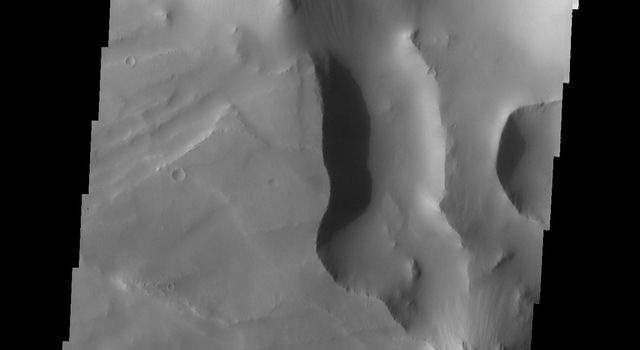 This image from NASA's Mars Odyssey spacecraft shows Noctis Labyrinthus located at the western end of Valles Marineris on Mars. This maze-like feature of deep intersecting valleys was formed by tectonic forces and extensive faulting.