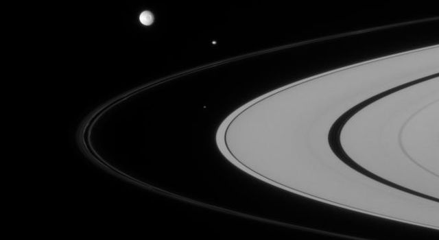Three of Saturn's closest-orbiting moons are captured here, rounding the rings. They include Atlas, Pandora, and Mimas, captured by NASA's Cassini spacecraft on Sept. 6, 2007.