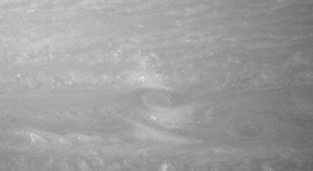 Monster storms, or vortices, swirl in the roiling atmosphere of giant Saturn. This image was taken by NASA's Cassini spacecraft's narrow-angle camera on Aug. 14, 2007.