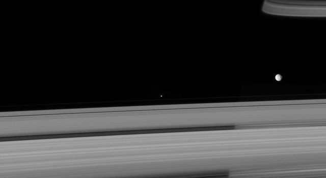 Two of Saturn's icy attendants, Pandora and Mimas, race past on their circuit of the ringed beauty in this image taken by NASA's Cassini spacecraft on Sept. 8, 2007.