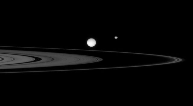 NASA's Cassini spacecraft observes a gathering of three moons, Mimas, Epimetheus, and Daphnis, near the rings of Saturn in this image taken on Oct. 3, 2007.