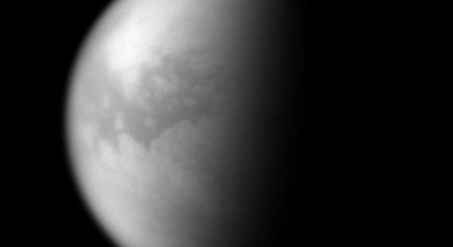 Through the obscuring haze come glimpses of Titan's dune seas. The dark, equatorial region known as Shangri-la is visible here. This image was taken with NASA's Cassini spacecraft's narrow-angle camera on Oct. 19, 2007.
