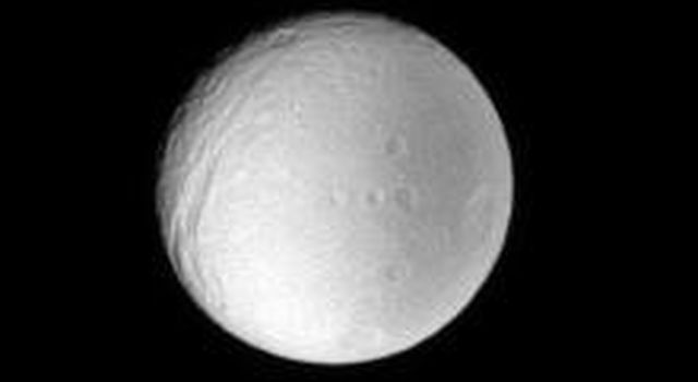 This low resolution view of Tethys provides scientists with useful information about the moon's surface properties, regardless of the image's small size. This image was taken with NASA's Cassini spacecraft's narrow-angle camera.