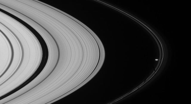 Prometheus and Pandora, Saturn's F-ring shepherd moons are seen in this view from NASA's Cassini spacecraft taken on Dec. 6, 2007, which also features narrow ringlets in the Encke gap at left.