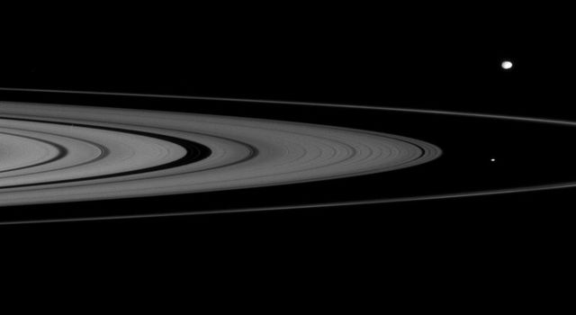 On Jan. 17, 2008, NASA's Cassini spacecraft spied two of Saturn's small moons, Atlas and Epimetheus, that skirt the edges of the planet's rings.