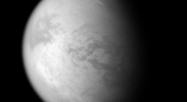 A bright streak of cloud graces the northern skies of Titan. This is the second time NASA's Cassini spacecraft's imaging cameras have spotted clouds at 60 degrees north latitude on Titan.