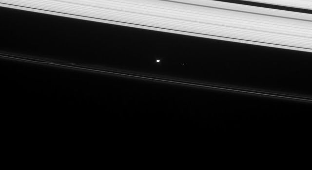 Prometheus shines brightly in this image from NASA's Cassini spacecraft, taken on Jan. 22, 2008, as part of the ongoing campaign to precisely determine the orbits of Saturn's small moons.