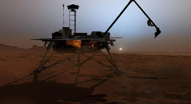 In this artist's concept illustration, NASA's Phoenix Mars Lander begins to shut down operations as winter sets in. The far-northern latitudes on Mars experience no sunlight during winter.
