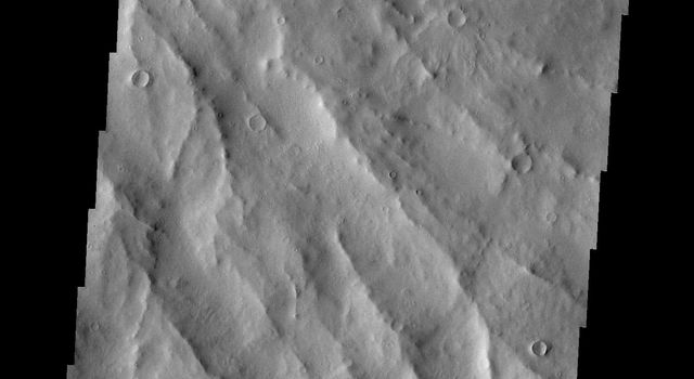 This image from NASA's Mars Odyssey spacecraft shows the eroded southeastern flank of Apollinaris Patera, an old volcano on Mars that has undergone extensive erosion.