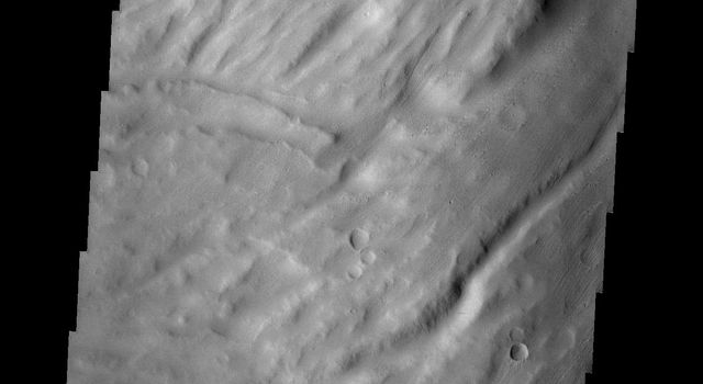 This image from NASA's Mars Odyssey spacecraft shows the southwestern flank of Apollinaris Patera, an old volcano on Mars that has undergone extensive erosion.