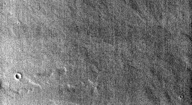 This image from NASA's Mars Odyssey spacecraft shows half of Ulysses Patera on Mars.