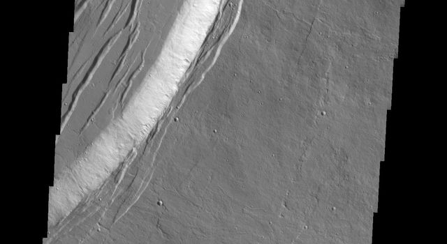 This image from NASA's Mars Odyssey spacecraft shows the summit of Olympus Mons on Mars.