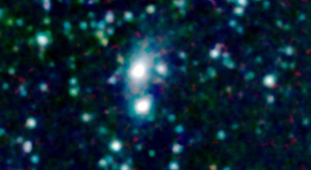 A big galaxy is stealing gas right off the 'back' of its smaller companion in this new image from NASA's Spitzer Space Telescope. The stolen gas is hot, but it might eventually cool down to make new stars and planets.