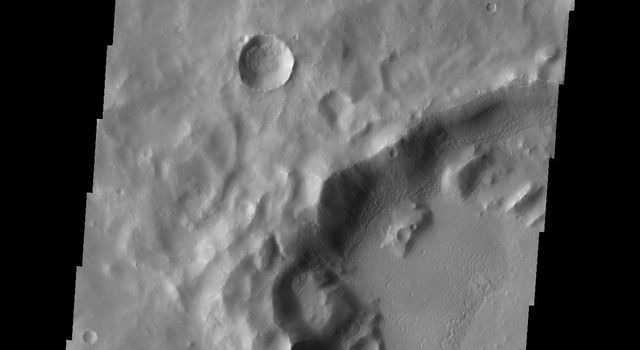 This image from NASA's Mars Odyssey shows a small channel on Mars that enters the crater appearing to become a ridge as it crosses onto the crater floor.