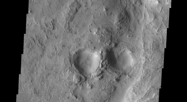 This image from NASA's Mars Odyssey shows transverse dunes and narrow ridges found near the channel of Huo Hsing Vallis on Mars.