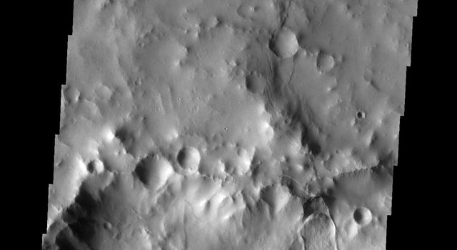 This image from NASA's Mars Odyssey shows a landslide deposit on the northern rim of Montevallo Crater on Mars.