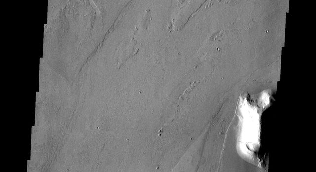 This image from NASA's Mars Odyssey shows channels and streamlined islands, part of Marte Valles on Mars, an extensive set of lava channels.