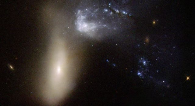 NGC 454 is galaxy pair comprising a large red elliptical galaxy and an irregular gas-rich blue galaxy. This image is part of a large collection of images of merging galaxies taken by NASA's Hubble Space Telescope.