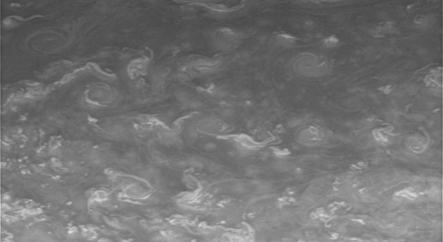 Twirling vortices swim through a vast ocean of hydrogen and helium in Saturn's far north. This image was taken with NASA's Cassini spacecraft narrow-angle camera on May 23, 2008.
