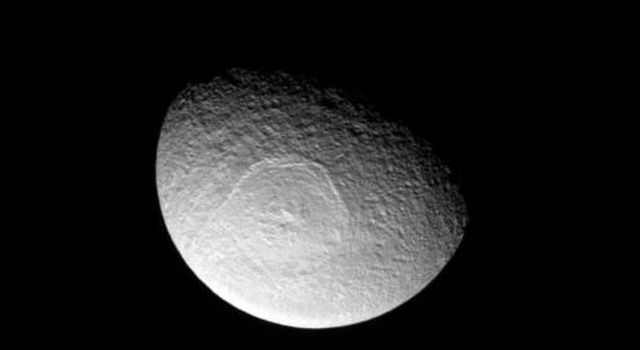 Saturn's icy moon Tethys sports an enormous impact basin, Odysseus. The impact basin is 280-miles wide and contains a central complex of mountains. This image was taken in visible light with NASA's Cassini spacecraft's narrow-angle camera.