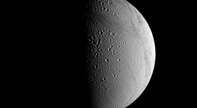 Craters on Saturn's moon Enceladus tend to be modified by a couple of different processes that are visible in this view captured by NASA's Cassini spacecraft. This view looks toward terrain near the north pole.
