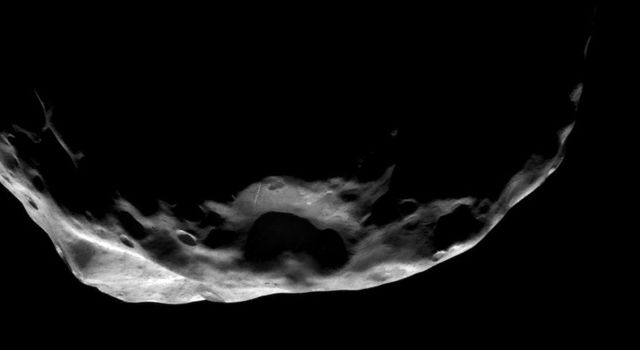 This shadowy scene is one of NASA's Cassini spacecraft's closest views of Saturn's moon Janus taken on June 30, 2008.