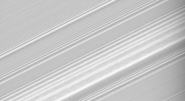 This high-resolution view from NASA's Cassini spacecraft, taken on July 21, 2008, shows incredible detail within a spiral density wave within Saturn's A ring.