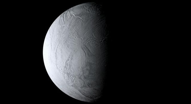 As NASA's Cassini spacecraft sped away from Enceladus following its close August 2008 flyby, the moon's wrinkled south polar region remained in view.