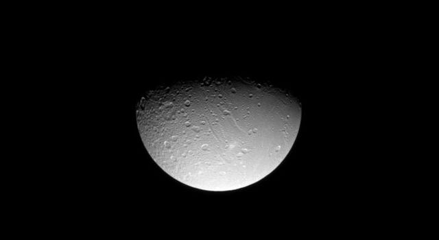 NASA's Cassini spacecraft gazes down at linear tectonic features in Saturn's moon Dione's northern hemisphere. This image was taken in visible light with the Cassini spacecraft narrow-angle camera on Aug. 3, 2008.