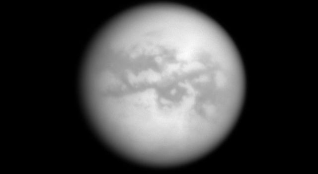 NASA's Cassini spacecraft looks through Titan's thick atmosphere to reveal bright and dark terrains on the Saturn-facing side of the planet's largest moon.