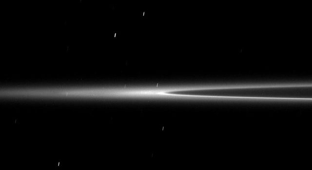This low elevation image shows the G ring arc discovered by NASA's Cassini spacecraft. This faint arc of material is maintained by a gravitational interaction with the moon Mimas.