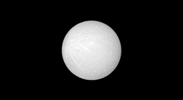 NASA's Cassini spacecraft acquired this view of Rhea's leading hemisphere near 'opposition,' or with the Sun almost directly behind the camera.