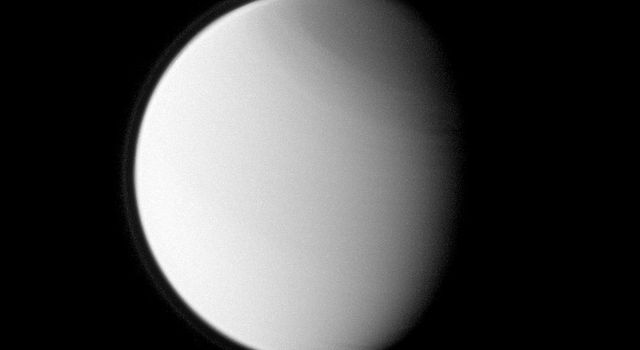 Titan's globally distributed detached haze layer and the moon's north polar hood, both notable details of its thick atmosphere, are clearly seen in this image from NASA's Cassini spacecraft. Titan is 5,150 kilometers across, slightly larger than Mercury.