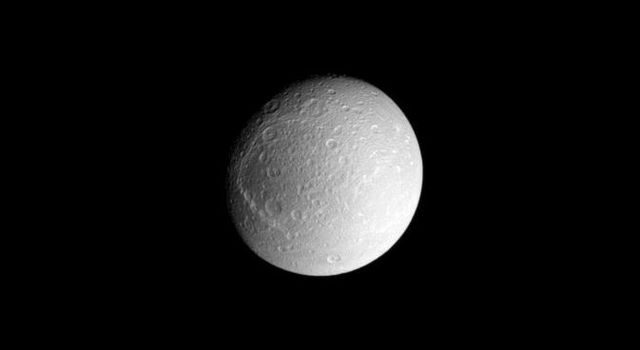 Dione's dark trailing hemisphere (toward the left) and bright leading hemisphere are both visible in this view centered on the moon's anti-Saturn facing side. This image was taken in visible light with NASA's Cassini spacecraft's narrow-angle camera.