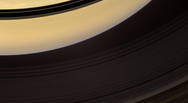 Shadows cast onto Saturn by its rings, visible here as dark bands, move steadily towards the equator and grow thinner as equinox approached on on Nov. 22, 2008. This image is from NASA's Cassini spacecraft.