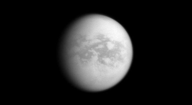 Named for other-worldly paradises, the dark regions of Senkyo and Aaru comprise the center of this image of Saturn's moon Titan. This image was taken with NASA's Cassini spacecraft's narrow-angle camera on Dec. 12, 2008.