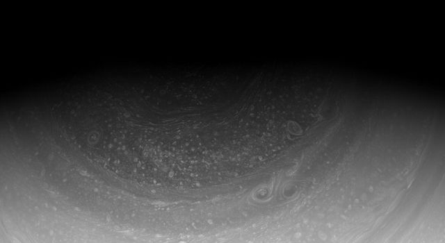 Cassini imaging scientists have waited years for the sun to reveal the hexagonal wave pattern in the clouds of Saturn's north pole, part of which can be seen at the top of this image from NASA's Cassini spacecraft.
