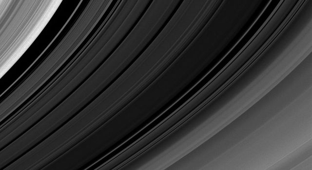 The simple beauty of Saturn's rings, curving lines of varied shades that have surrounded the planet for eons, is captured in visible light in this image from NASA's Cassini spacecraft taken on Jan. 14, 2009.