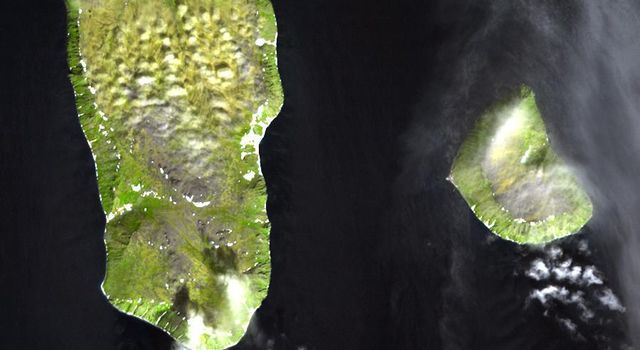 The Diomede Islands consisting of the western island Big Diomede, and the eastern island Little Diomede are two rocky islands located in the middle of the Bering Strait between Russia and Alaska. This image was acquired by NASA's Terra satellite.