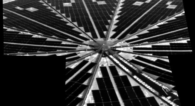 Shown here is one of the first images taken by NASA's Phoenix Mars Lander of one of the octagonal solar panels, which opened like two handheld, collapsible fans on either side of the spacecraft.