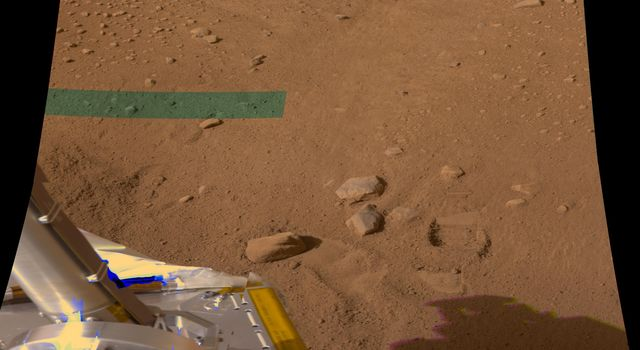 NASA's Phoenix Mars Lander shows a hole in the ground produced by the first Robotic Arm dig at its landing site on Mars.